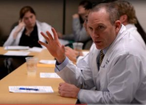 Tom Purcell, MD, MBA, is shown during a neuroendocrine multidisciplinary clinic.