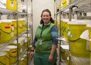 CU School of Medicine Pathologist Carrie Marshall, MD, is shown in the Organ Room of tissues used for training and outreach.