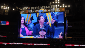 Val Sotelo, a UCHealth Memorial Hospital employee, is shown on the big screen at a Denver Nuggets basketball game.