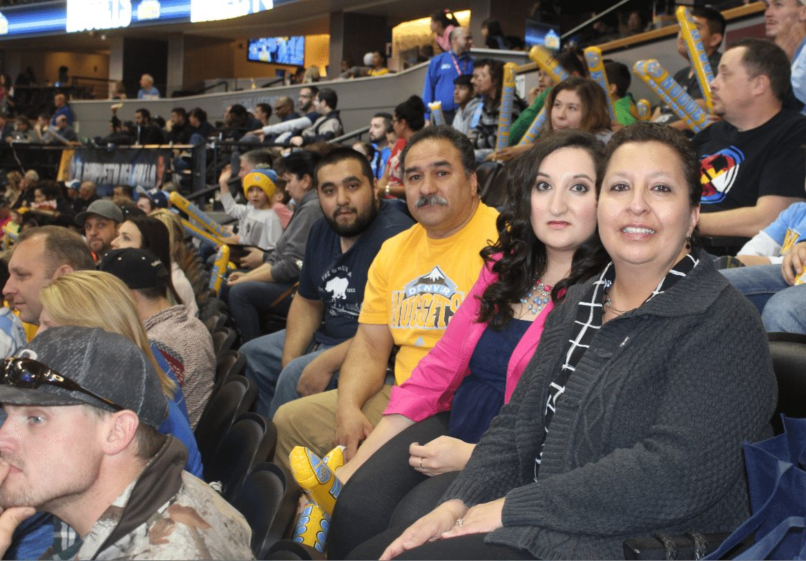 Val Sotelo (far right), is joined by her son, Nate; husband, Gus; and daughter, Shawna; during a recent Denver Nuggets game.