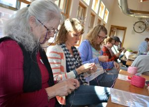 Janet Slagle and Randine Nelson, both of Fort Collins are shown knitting at the Knit for a Cause Knit-A-Thon in Fort Collins.