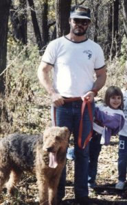 Nicole Caputo is shown hiking with her father and their family dog.