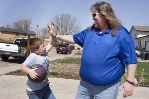 Brian Gary is shown giving his grandson a high five.