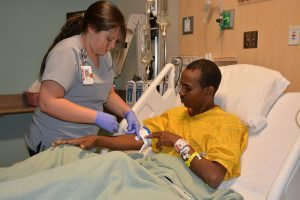 Bahta Wibshet receives care from a nurse at UCHealth Memorial Hospital.