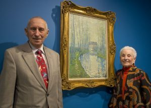 Morton Mower, MD and his wife, Tobie Mower, are pictured in front of a painting by Claude Monet.