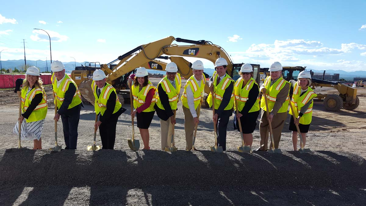A big group of people in yellow vests and construction helmets gathers at UCHealth Highlands Ranch Hospital for a groundbreaking on May 24, 2017. From left, Amy Sherman, president of Northwest Douglas County Economic Development Corp., John Kilrow, senior vice president of Colorado Development, Dr. Tom Purcell, chief medical officer for UCHealth Highlands Ranch Hospital, Lori Thomas, Douglas County commissioner, Sean Menogan, vice president UCHealth Facilities Design and Construction, Mike Ross, senior project manager for Mortenson, Will Cook, president and CEO of UCHealth University of Colorado Hospital, Diane Cookson, president and CEO of UCHealth Highlands Ranch Hospital, Robert Golden, South Metro Denver Chamber of Commerce president and CEO, and The Rev. Julie Swaney, UCHealth senior chaplain and manager of Spiritual Care Services at UCH.