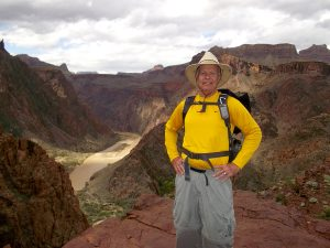 Phil Sheridan gets ready to head down into the Grand Canyon. He dresses for protection and now attends an annual skin cancer screening.