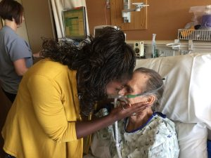 Nurse Tiffanie Miller says goodbye to her patient, George Neuberger Jr. as he sits in his hospital bed.