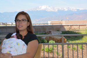 Alexandra Cordero holds her new baby, Elena, outside of Memorial Hospital North.