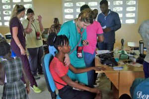 Andrea Hooley, registered nurse and transitional care case manager for UCHealth Family Medicine Center Residency, triages a patient in Haiti.
