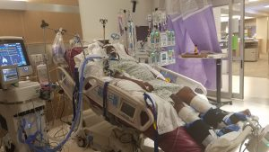 David Kenyatta lays in a hospital bed soon after his stroke.