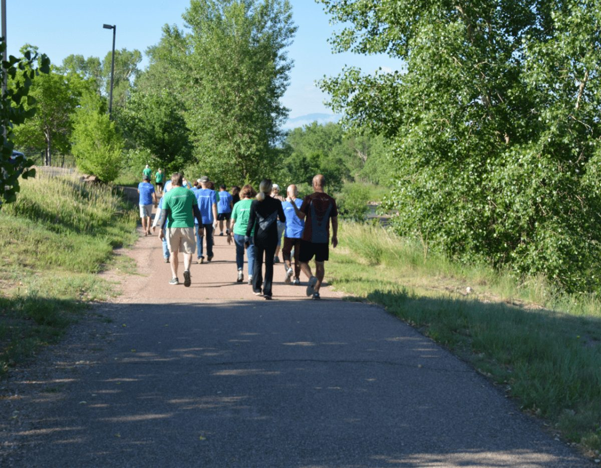 "Dr. Laurence (Larry) Cohen leads a group of walkers along the Pikes Peak Greenway Trail in Colorado Springs. On Sunday mornings, Cohen hosts a ""Walk with a Doc'' outing."