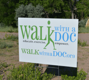 "A picture of a sign that says ""walk with a doc''"