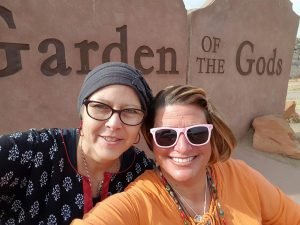 A photo of Yvette Engel and Jennifer Reid snapping a selfie at the Garden of the Gods, Colorado Springs' spectacular city park.
