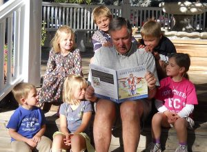 "Kirk Hall reads his children's book, ""Shaky Paws Grampa,"" to his grandkids"