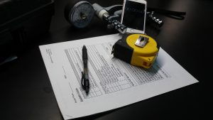 A few of the simple tools needed for a frailty assessment: grip measurement instrument, a tape measure for walking speed, a smartphone (which plays the role of a stopwatch in recording walking time), a consent form and a pen for filling it out. The data gleaned from these low-tech items could yield powerful data in predicting surgical outcomes for patients with brain tumors.