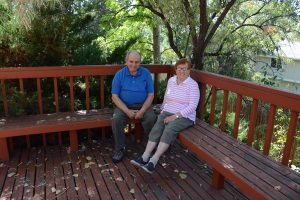 Dina and Leon Altschul sit outside on their deck.