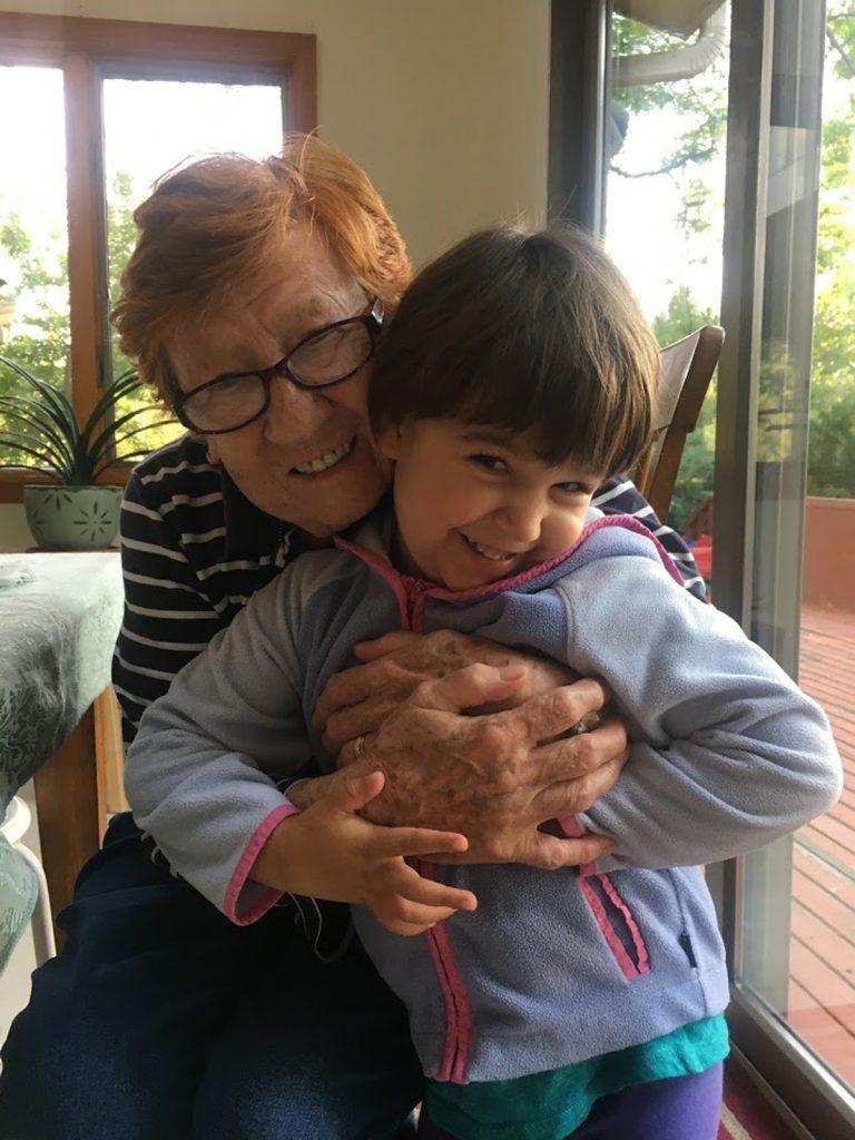 Dina Altschul hugs her grandchild.