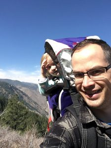 Dr. Michael Dewey hiking with his daughter. He helps people handle sleep issues and the fall time change.