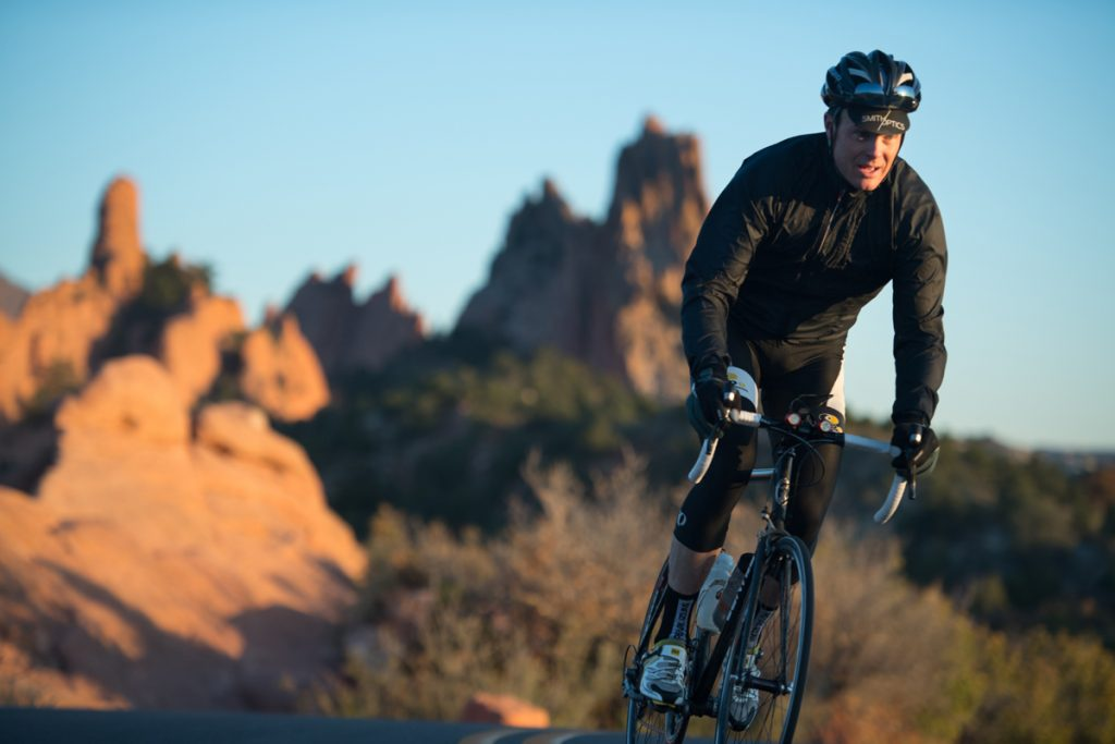 Zach Owen rides his road bike in the Garden of the Gods.