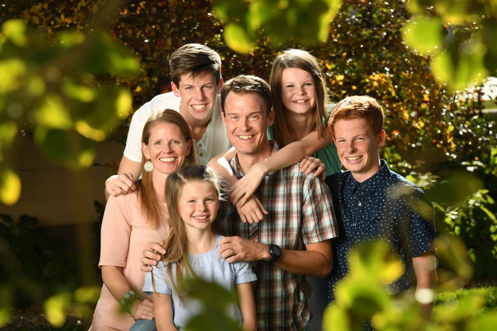 Zach Owen and his wife, Ginet, at home with their kids, left to right, Wyatt, Addie, Summer and Bodie