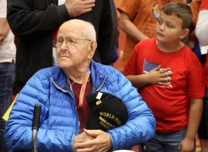 WWII Pfc. Jim Ingram and his grandson listen to the National Anthem during the Honor Flight Northern Colorado send-off celebration on Sept. 17, 2017 at Embassy Suites in Loveland.