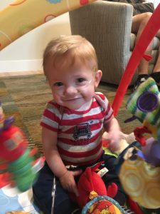 Finn, a babies born extremely premature success story, plays with his toys.
