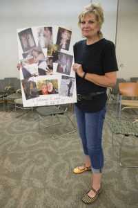 Sherry Bockelmann with her own collage, which highlights activities she couldn't have done before.