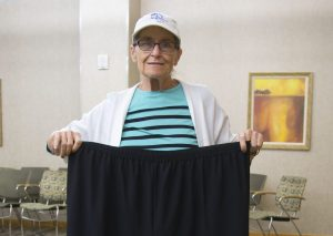 Jeanie Roe holding large stretch pants she use to wear.