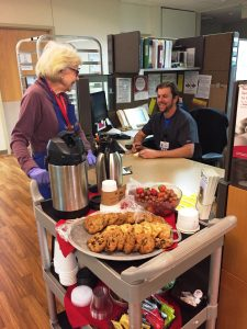 """Joan Gibbs, known as """"the Cookie Lady,"""" is shown passing out cookies."""