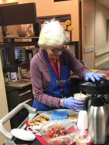 """In this photo, Joan Gibbs, known as """"the Cookie Lady,"""" pours coffee."""