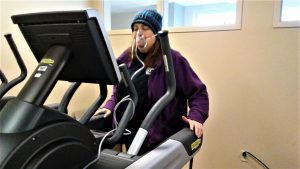 Erin M. is shown on an elliptical machine as part of her pulmonary rehabilitation at UCHealth University of Colorado Hospital.