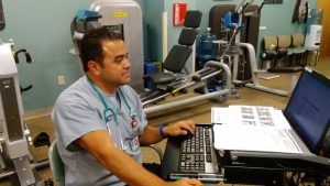 Respiratory therapist Hector Grajeda monitors patients' exercise in this photo.