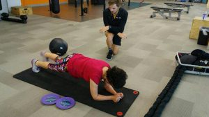Andrea Meyers is shown exercising.