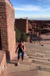 Gail Sadler is picutred running up the stairs at Red Rocks Amphitheater.