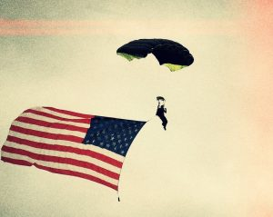 A person is shown with a parachute.