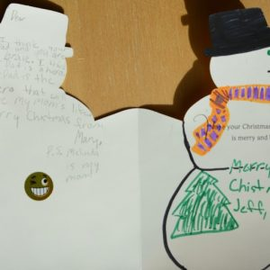 """A snowman Christmas card shows a note from Melinda Ray to the children of her mom's liver donor. She wrote: """"Your dad is the hero that will save my mom's life. Merry Christmas from Mary. P.S. My mom is Melinda."""""""