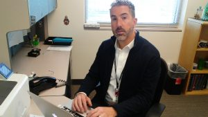 Dr. Aryeh Fischer, a UCHealth rheumatologist, sits at his desk.