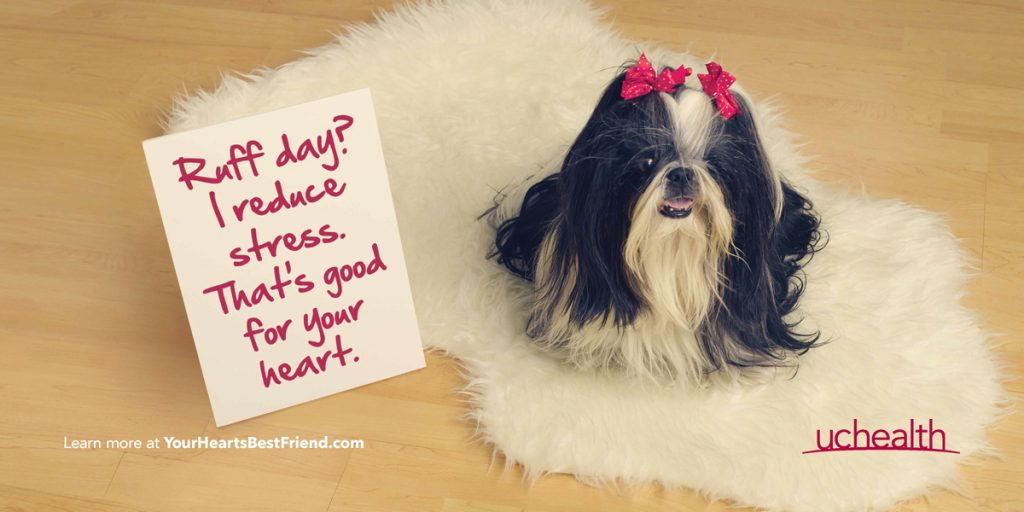 picture of a dog with a sign that reads: Ruff day? I reduce stress. that's good for you heart.
