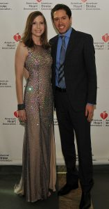 Becky and Jeremiah Pomerleau pose in formal attire at an event promoting the American Heart Association.