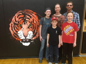 Marcy and Kurt Brossman with their children, Makayla, Kenzie and Kooper at the Cheyenne Wells School.