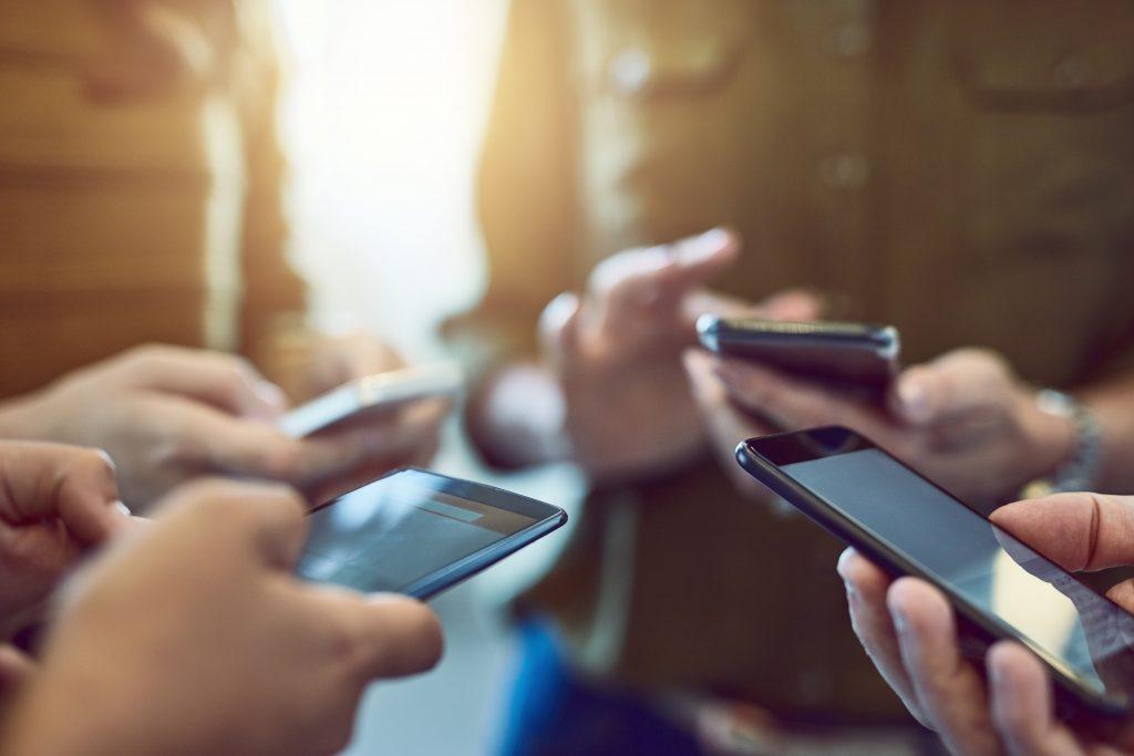 people looking at their smart phones