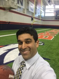 Dr. Jani in a selfie at the Denver Broncos training facility.