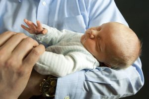 Cancer success then a new baby. Beckett Leffler in his dad's arms.