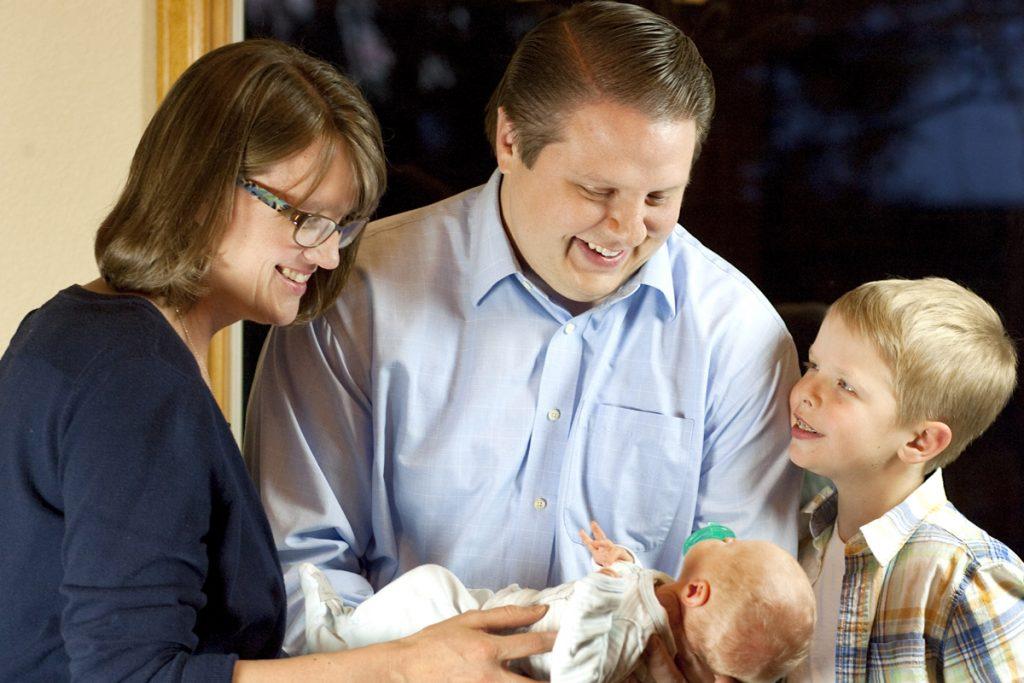 Jennifer and Chris Leffler with their sons, Beckett, center, and Elliott, 8.