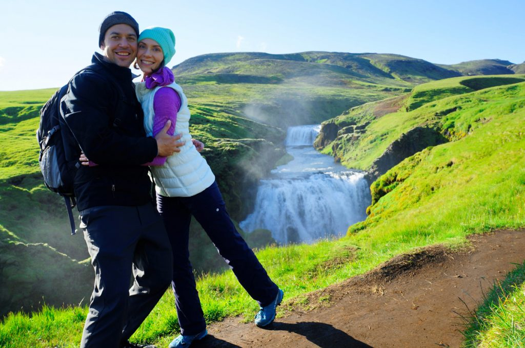 Life-changing ICL surgery has made it possible for Nikole Rachelson to enjoy the outdoors more than ever. Here, she hikes with her husband on an emerald-green slope in Iceland.