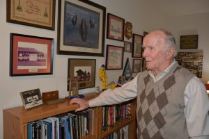 Air Force Ret. Maj. Gen. Halloran in his home office, showing momentos from his Air Force career.
