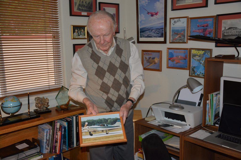 Air Force Ret. Maj. Gen. Halloran is at home in an office, where he keeps memorabilia from his career in the Air Force.