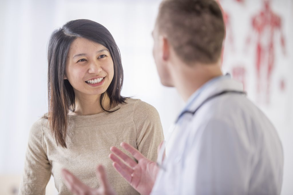 A photo of a woman talking to a doctor