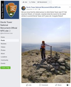 An image of a facebook post from the National Park Service featuring Robert Kelman at the top of Devils Tower.